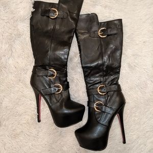 Black heeled boots with side buckles